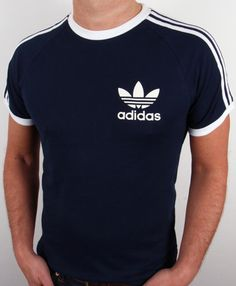 Adidas Originals Retro 3 Stripes T-shirt Navy. We stock a great range of Adidas 3 stripe California trefoil tees in a range of colours. Adidas Originals, The Originals, Adidas Retro, Adidas Vintage, Sergio Tacchini, Mens Trends, Adidas Outfit, Moda Fitness, Outdoor Outfit
