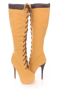 Be comfy yet stylish this season with these fashionable knee high boots! They will go perfect with your favorite dress or skinnies! Make sure you add these to your closet, it definitely is a must have! The features include a nubuck faux leather upper with a lace up tie design, stitched round closed toe, faux leather puffed trim, stitched detailing, smooth lining, and cushioned footbed. Approximately 5 1/2 inch heels, 1 1/2 inch covered platforms, 15 inch circumference, and 15 inch shaft…