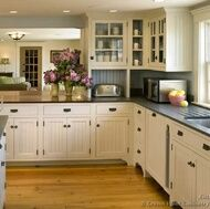 I love everything about this kitchen. I love the cement counter tops, and the white cabinets
