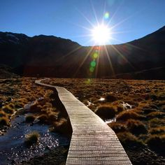 The starting view as the sun rose over our pathway on the Tongariro Crossing trek in New Zealand.  ••••••••••••••••••••••••••••••••••••••••• WorldlyNomads.com •••••••••••••••••••••••••••••••••••••••••