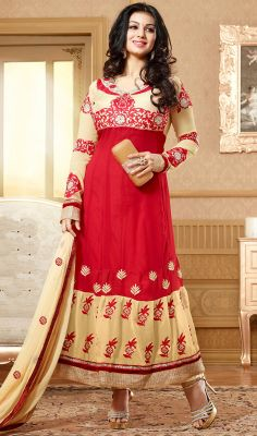 Look ravishing like Ayesha Takia dressed in this red and cream shade faux georgette long kalidar suit. Kameez features contrasting yoke and lower part embroidered with foliage patterns and motifs. Contrasting hemline forms the quintessence of the attire.  #AnarkaliDress