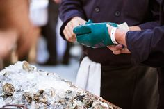 Wine & Spirits Magazine 9th Annual Top 100 Tasting Event 2012, Hog Island Oysters being shucked.