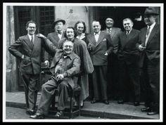 The Belgian Surrealist group, Le café La FleurFrom left to right: Marcel Mariën, Camille Goemans, Gérard Van Bruaene, Irène Hamoir, Georgette Magritte, E.L.T. Mesens, Louis Scutenaire, René Magritte and Paul Colinet.