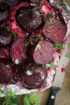 Healthy red baked beets with butter, chardonnay and fresh oregano