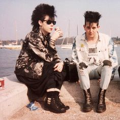 80s new wave fashion - jean jackets, cross earrings, Mohawks, Ray Bans