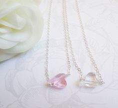 This Swarovski sideways heart flower girl necklace is an adorable way to say thank you! She will love the sparkle of the crystal heart! It comes