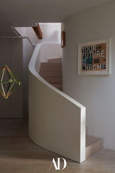 This family of four turned their home into a haven by bringing in colorful art, sophisticated paintings, and greenery galore. #stairs #staircases #art #design #neutral #minimalist #chandelier Saarinen Table, Office Nook, Inviting Home, House Entrance, Architectural Digest, Grey Walls, Dom, Home And Family, Furniture Design