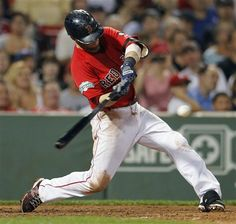 Boston Red Sox's Dustin Pedroia hits a one-run single in the fifth inning of a baseball game against the Toronto Blue Jays in Boston, Friday, Sept. 7, 2012. (AP Photo/Michael Dwyer)