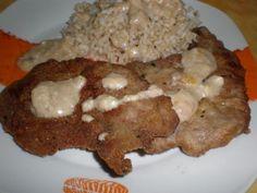 Escalopes de aguja, con arroz integral, regado de salsa blanca