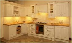 Image result for cream color kitchen cabinets