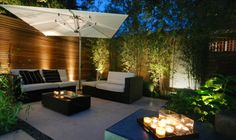Paving, furniture and lighting makes this space look so inviting