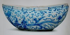 Begging bowl (kashkul) Iran, 1640s Ceramic, stone paste body, underglaze-blue decorated, 12,5 x 31 x 11,5 cm Private coll.  Exhib. BM Shah Abbas The Remaking of Iran, cat. n°54
