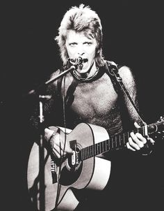 Ziggy Stardust era David Bowie and acoustic guitar on stage