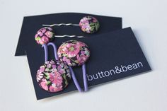 Liberty of London floral fabric covered button hair accessories hair ties and mini bobby pin pair by buttonandbeanbespoke on Etsy https://www.etsy.com/listing/235993617/liberty-of-london-floral-fabric-covered