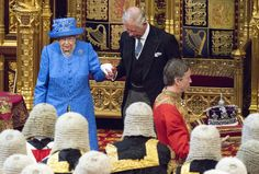 Queen Elizabeth II Photos Photos - Queen Elizabeth II (L) and Prince Charles, Prince of Wales during the State Opening of Parliament in the House of Lords at the Palace of Westminster on June 21, 2017 in London, United Kingdom. This year saw a scaled-back State opening of Parliament Ceremony with the Queen arriving by car rather than carriage and not wearing the Imperial State Crown or the Robes of State. - The State Opening Of Parliament 2017
