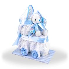 More - Diaper Carriage Boy Baby Gift. Diaper Carriage Boy Baby Gift This diaper carriage rocks! What can be cuter or more unique than our Baby Diaper Carriage? A clever twist on the traditional diaper cake, this adorable Baby Shower Gift Basket, Baby Shower Diapers, Baby Boy Shower, Baby Shower Gifts, Diaper Cake Centerpieces, Baby Shower Centerpieces, Baby Shower Decorations, Baby Decor, Baby Gift Sets