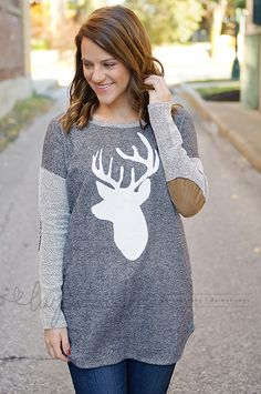 French terry top with suede elbow patches and white deer silhouette on front.