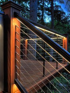 Feeney LED Lighting for DesignRail®: Feeney's custom designed LED lights and Lens installed in stair railing and deck railing. Detail shows 150 CapRail on stair railing, 200 CapRail on level railing. CableRail Quick-Connect® fittings used.