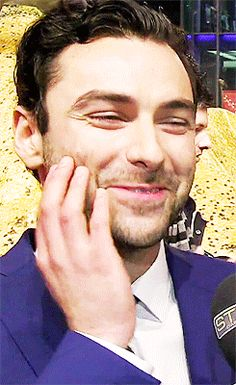 Aidan Turner. He has the most beautiful smile ever. I don't care how many times I pin this, I can't resist