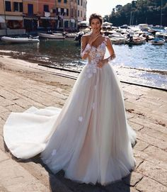 Dress of the Week - Viero Bridal   A fairytale princess wedding dress with floral details all-over and tattoo-effect bodice.