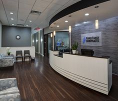 Fisher Family Chiropractic Great example of using charcoal gray as the accent but keeping other surfaces light.  Love the kid's area hidden away. Notice how the gyp. bd. furrdown over the reception desk gives it such a professional look.