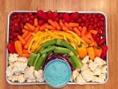 Rainbow vegetable tray with dip dyed blue with food coloring. We also made purple dip by grating red cabbage into veg dip (grated red cabbage was perfect for a natural purple food coloring)