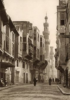 """Another day begins in old Cairo. This street passes beneath the Aksunkor Mosque, called el-Azrak, or """"the blue"""", because of it's vibrantly colored tiles"""