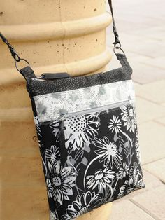 This stylish bag is just the right size to hold your essentials and is perfect for taking to quilt shows, for travel, or to use as a runaround bag. The bag