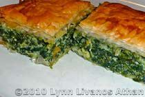 "Spinach Pie with Feta - Spanakopita -flaky phyllo sheets are layered with a savory spinach and feta cheese filling. Spanakopita can be made as a ""pie"" or pita, or as individual phyllo triangles."