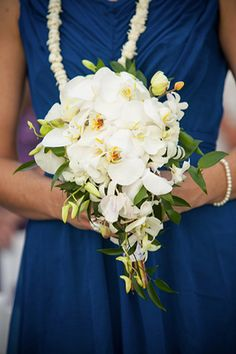 White orchid bouquet for this Hawaiian destination wedding. Photography by Bob Brown from hawaiiphotographer.com