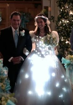 Here is a picture of a LED wedding dress from the sitcom ModernFamily. This is the first example I thought of when thinking about the term wearable technology. Dystopian Fashion, Cyberpunk Fashion, Wearable Technology, Fashion Technology, Bridal Gowns, Wedding Gowns, Light Up Dresses, Dress Makeup, Future Fashion