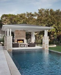 Love the idea of a cabana and fire place on the opposite side of the pool!