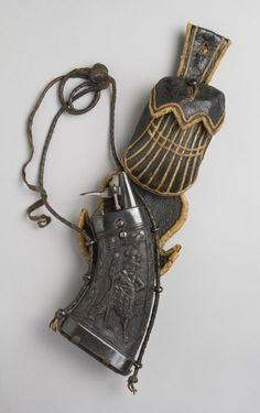 Powder Flask, Bullet Pouch, and Spanner of the Guard of a Prince Elector of Saxony  Artist/maker unknown, German  Geography: Made in Saxony, Germany, Europe Date: c. 1600-1625