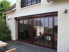 Une maison ouvrière s'offre une extension vintage baie vitrée aluminium