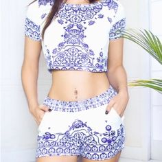"""Porcelain/Blue Crop Top/Shorts This is a porcelain and dark blue crop top and shorts set. The necklace in the last picture is for sale in another listing. The material is Polyester but it feels kind of like Spandex. It would fit an extra small the best. A size small could wear it but the top would be tight and form fitting. It is a bit sheer so wear white or nude colored undergarments. The top is 15"""" long.  The shorts are 13"""" long and also have pockets. It fits like the first two pictures…"""