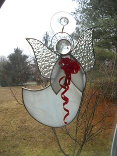 Stained glass Angel with shimmering wings