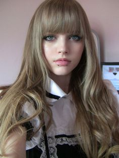 Long hair with straight across bangs.