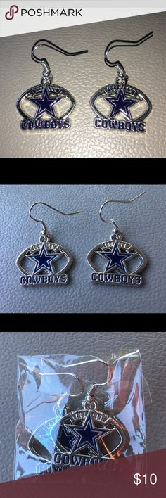 Dallas cowboys earrings costume jewelry NIP Thank you for viewing my listing, for sale is a pair of women's, Dallas Cowboys, football earrings. These earrings are metal, they do look silver but they are NOT silver. They have a football shape with the blue Star.  Great piece of costume jewelry to wear on Sundays while you're watching the Cowboys play.  They are appx 1 inch wide by 1/2 inch tall  Brand new in the package!! Never worn.  If you have any questions or would like additional photos…