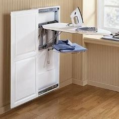 Our new laundry room design has pretty much left no room to tuck away our old ironing board. Let's see a show of hands…how many of us hate to drag out, set up and then fold away an iron…