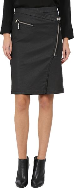 LOVE Moschino Women's Asymmetrical Zip Skirt Black Skirt. Bring new angles to your outfits wearing the LOVE Moschino® Asymmetrical Zip Skirt. A-line silhouette. Wrap style skirt. Asymmetrical hemline with zip and snap closure. Front zip pocket. Straight hemline. 98% cotton, 2% elastane. Machine wash warm, line dry. Imported. This item may ship with an attached security tag. Merchandise returned without the original security tag attached or a damaged tag may not qualify for a refund....