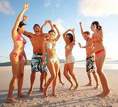 Reggae dancing on the beach in Barbados, Caribbean.
