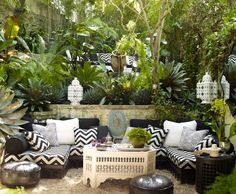 Moroccan Garden Patio: Inspired by Yves St. Laurent's Jardin Marjorelle in Marrakech, the structure and abundance of greenery on this patio are inspiring us to pour a glass of wine and commune with nature. (via Elle Decor) Patio Pergola, Backyard Seating, Garden Seating, Outdoor Seating, Outdoor Rooms, Backyard Patio, Outdoor Gardens, Outdoor Living, Outdoor Furniture Sets