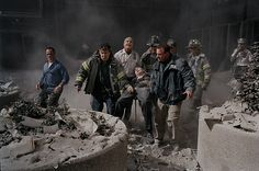 9/11 - World Trade Center Terrorism - New York Disaster. Rescue workers carry Fire Department Chaplin Father Mychal Judge's body from the rubble.  Father Judge was killed by falling debris. They took him to nearby St. Peter's Catholic Church, & laid him near the alter, before returning to help others.