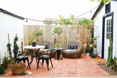 """This little patio area off the garage was a fun one to redo. It's a 10 x 10 area between the garage and what was the chicken coop, when we moved in. With the help ofHavenly,a new shed in place of the chicken coop, herringbone brick flooring, a fun bistro set and lounge chairs, we … Continue reading """"Our Backyard Bistro Area: The Reveal"""""""