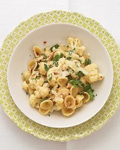 Orecchiette with Cauliflower: This easy pasta dinner calls for cauliflower, anchovies, and red-pepper flakes, a trio of ingredients often combined in classic Italian cooking. If you don't have orecchiette on hand, use penne or any other short pasta shape.