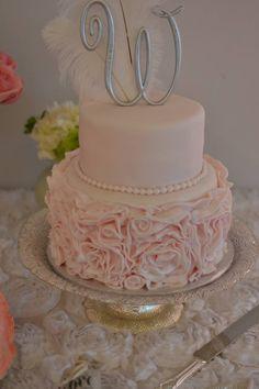 Blush Pink Rosettes adorn this elegant 2 tier cake.