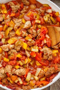 A quick and easy family meal that will surely have a few leftovers for you, this sausage and peppers over rice meal is tasty and gratifying!