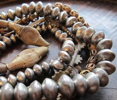 handmade sandcast bronze beads from Ghana and handmade Tuareg silver plated copper beads African Trade Beads, African Jewelry, Tribal Jewelry, Bohemian Jewelry, Beaded Jewellery, Beaded Necklaces, Costume Ethnique, Walmart Jewelry, Cremation Jewelry