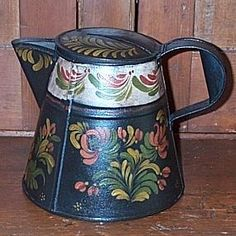 Painted tin coffee pot,tole painting did a little of this at one time..