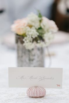Seashell place card: http://www.stylemepretty.com/little-black-book-blog/2015/01/29/vintage-elegance-at-haiku-mill/ | Photography: Jana Williams - http://jana-williams.com/
